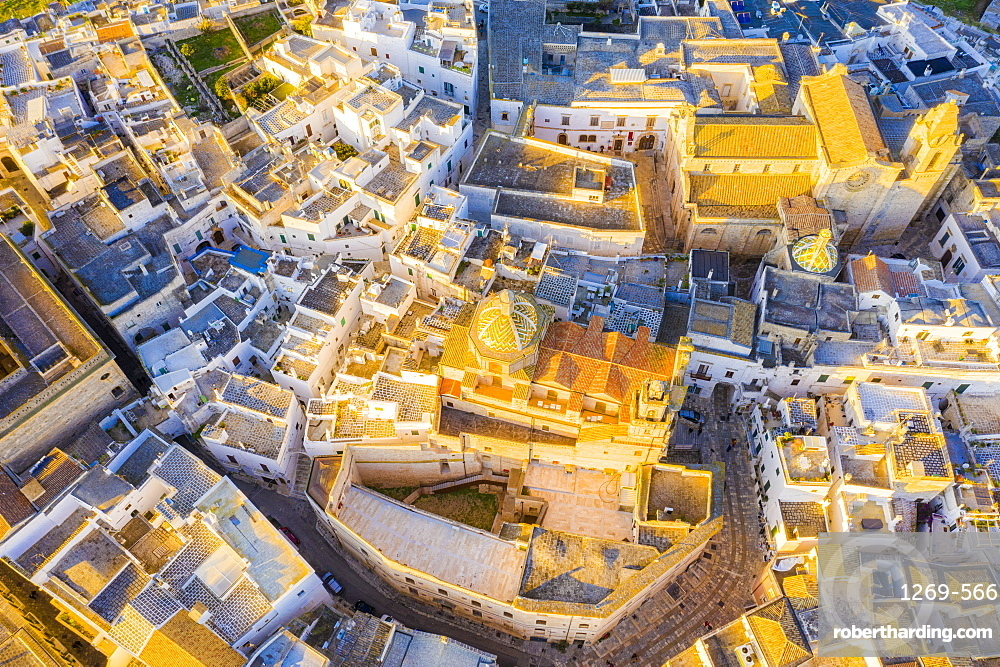 Zenithal aerial view of the old town of Ostuni at sunset, Apulia, Italy, Europe