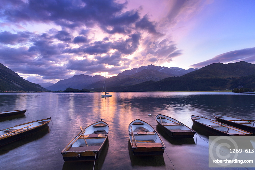 Moored boats in Lake of Sils at sunrise, Maloja Pass, Engadine valley, Graubunden, Switzerland, Europe