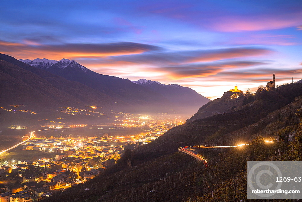 Lenticular sunset from vineyards of Valtellina, Lombardy, Italy, Europe