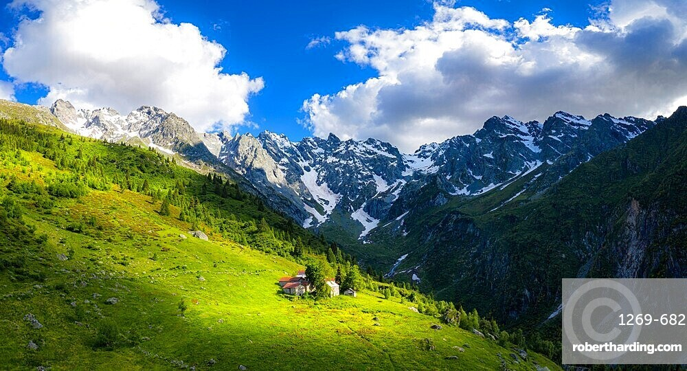Ancient group of huts illuminated by sun, Val d'Arigna, Valtellina, Orobie Alps, Lombardy, Italy, Europe
