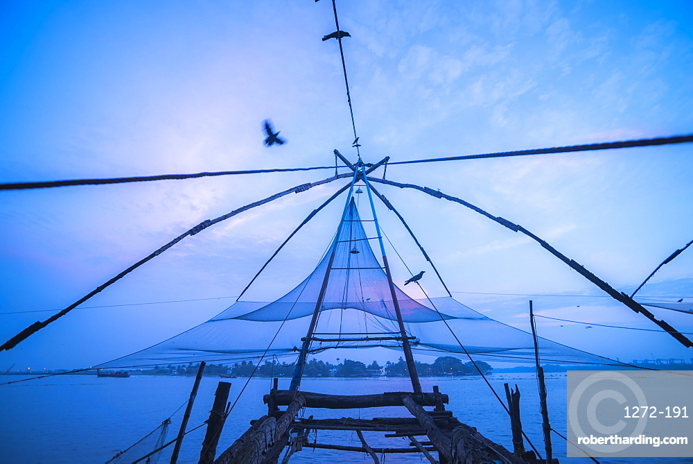 Traditional Chinese fishing nets at dawn, Fort Kochi (Cochin), Kerala, India, Asia