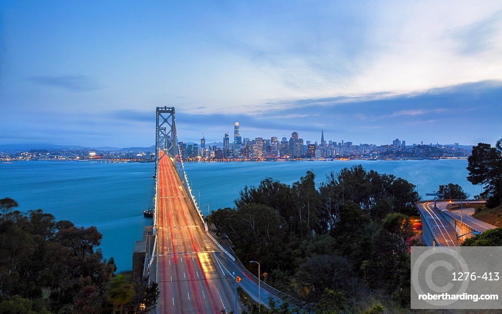 View of San Francisco skyline and Oakland Bay Bridge from Treasure Island at dusk, San Francisco, California, United States of America, North America