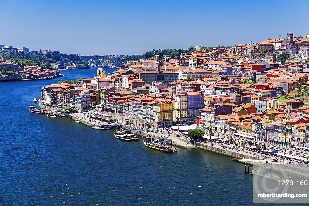 The Douro River banks with waterfront houses and boats seen from Dom Luis I Bridge, Porto, Portugal, Europe