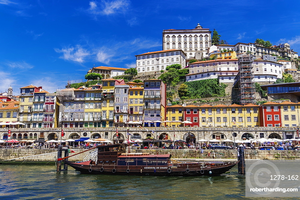 Traditional waterfront houses in the Ribeira district and boat on the Douro River, Porto, Portugal, Europe