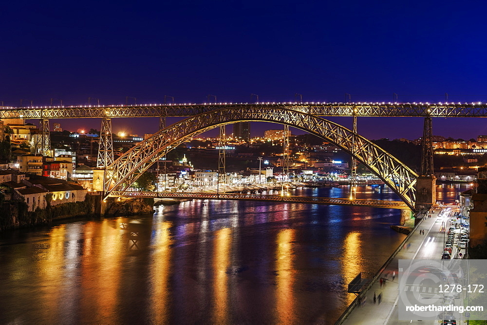 Night view of Dom Luis I Bridge over Douro River with Vila Nova de Gaia with traditional buildings in the background, Porto, Portugal, Europe