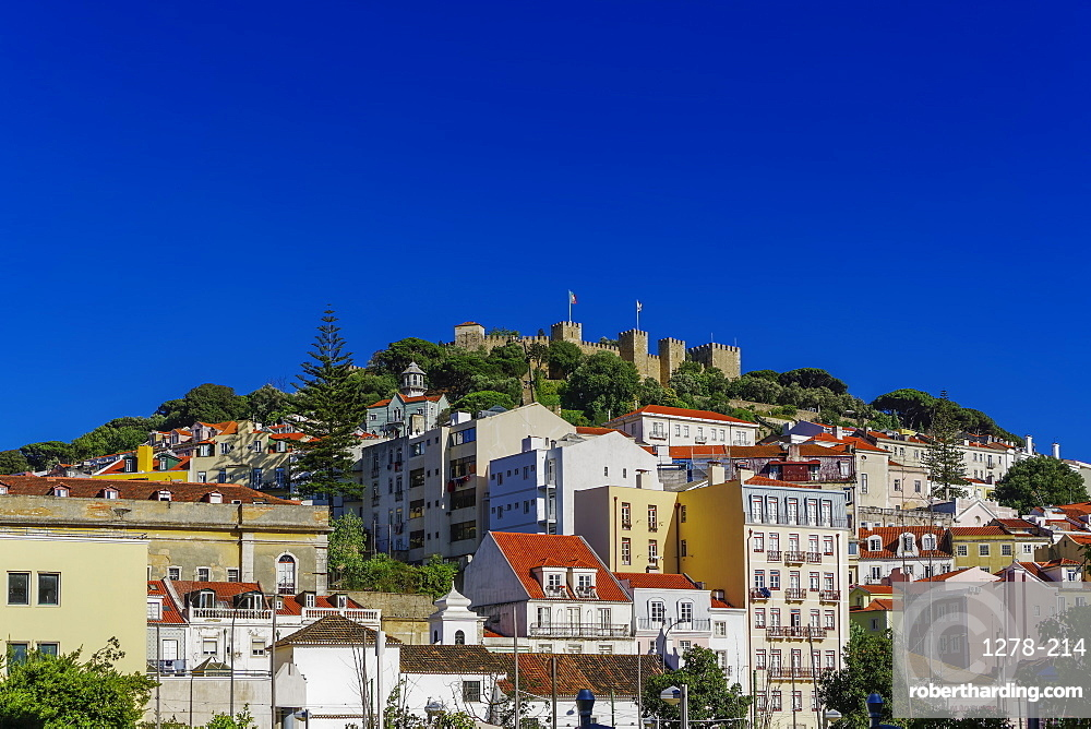 External view of The Castelo de Sao Jorge (St. George Castle) battlements, seen from city centre, Lisbon, Portugal, Europe