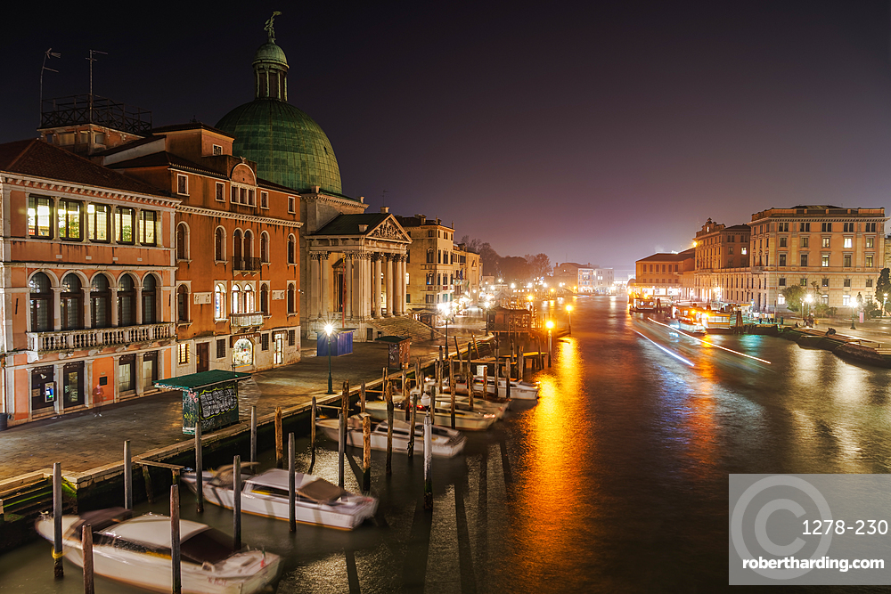 Grand Canal night view of San Simeon Piccolo with traditional buildings and wooden wharf pilings with moored boats, Venice, UNESCO World Heritage Site, Veneto, Italy, Europe