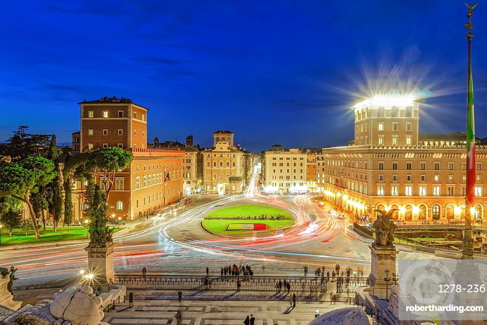Rome, Italy Piazza Venezia Venice Square with traffic blue hour elevated view from Altare della Patria Altar of the Fatherland.
