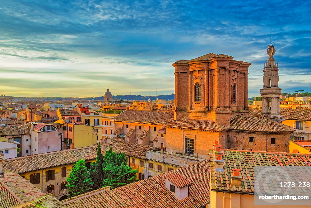 Rome rooftops landscape panorama with low-rise buildings & Basilica di Sant???Andrea delle Fratte golden hour elevated view.