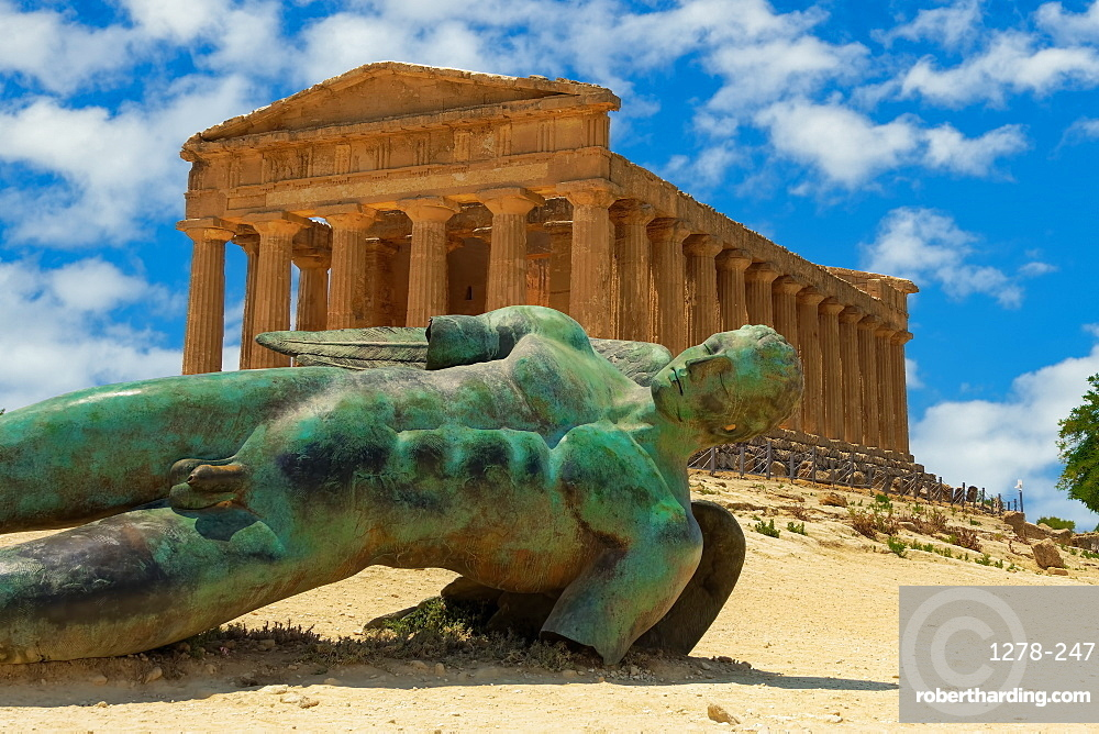 Agrigento Temple of Concordia with statue. Ancient Greek Doric temple with Fallen Icarus bronze statue in Valley of the Temples