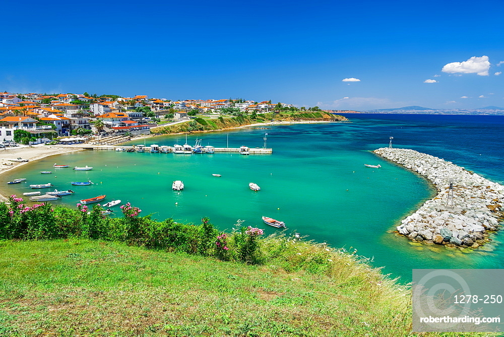 Chalkidiki, Greece coastal village with fishing port. Hilltop view of Nea Fokaia at Kassandra peninsula with low rise buildings