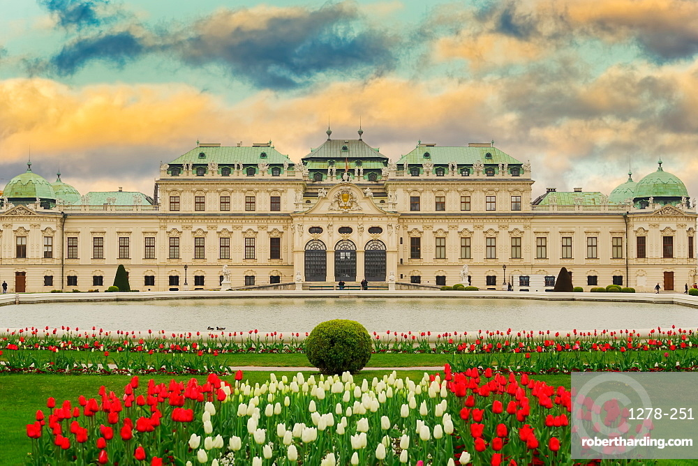 Exterior landscape of 18th century building, with garden flowers and pond, Upper Belvedere Baroque Palace, Vienna, Austria, Europe