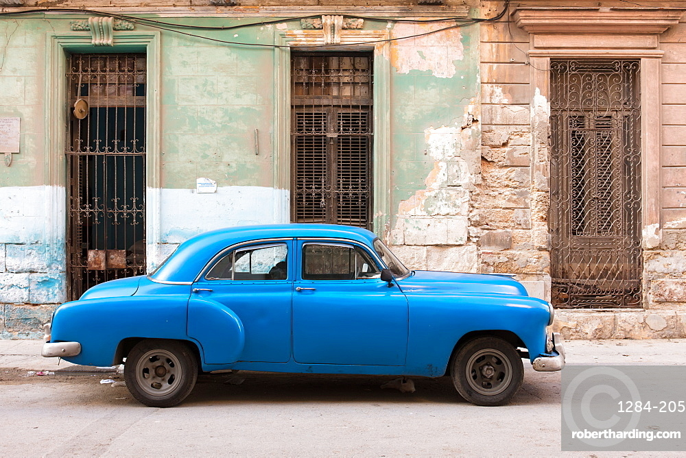 Old blue American car parked on street in Havana, Cuba, West Indies, Caribbean, Central America