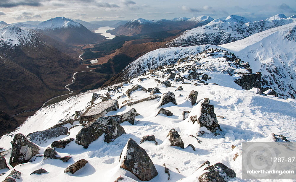 Looking down into Glen Etive and Loch Etive in distance from the summit of Stob Dubh on Buchaille Etive Mor, Highlands, Scotland, United Kingdom, Europe