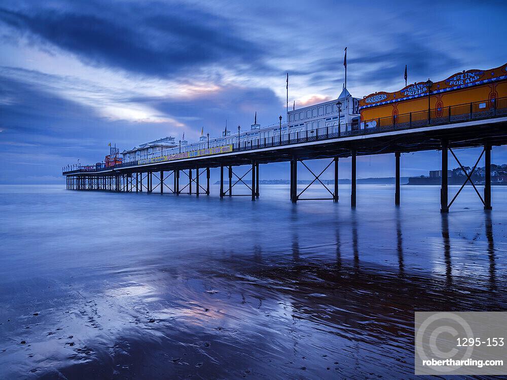 The photogenic Pier in dawn twilight at Paignton, Devon UK