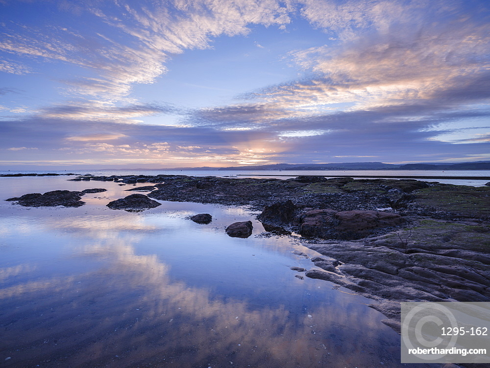 Winter sunset viewed from Maer Rocks, near Orcombe Point, Exmouth, Devon, England, United Kingdom, Europe