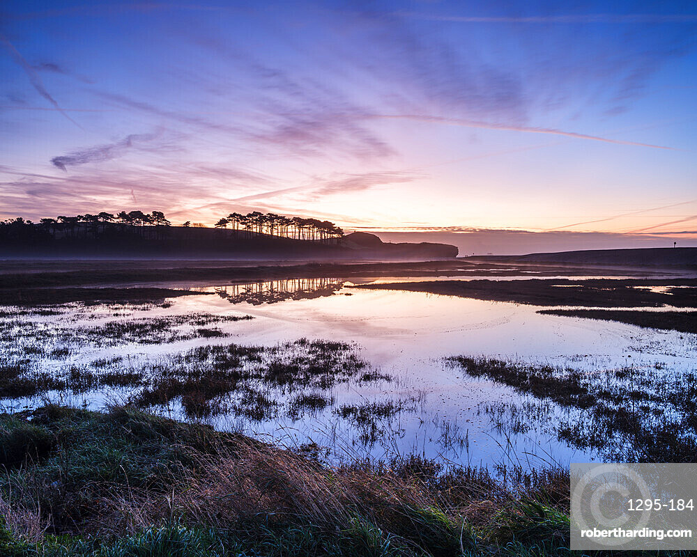 Winter twilight clouds and perfect reflections on the River Otter at Budliegh Salterton, Devon, UK
