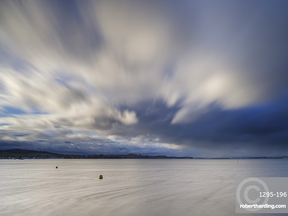 Stormy rain clouds blow down the Exe estuary at Exmouth, Devon, England, United Kingdom, Europe