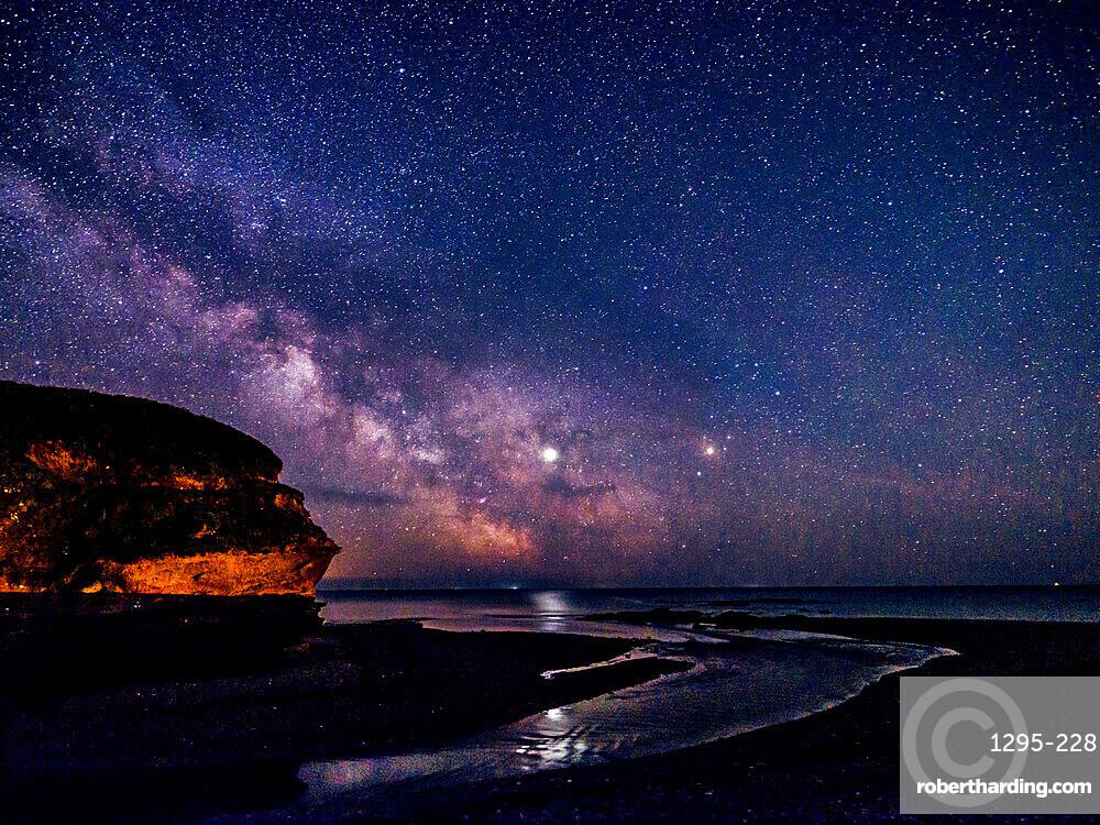 Milky Way and Jupiter beyond Otter Head at Budliegh Salterton, Devon, UK