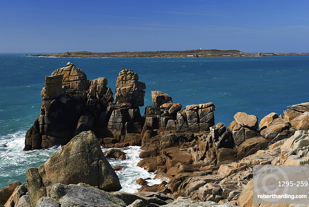 Granite rocks on a headland near Old Town, looking at Samsom, St. Mary's, Isles of Scilly, England, United Kingdom, Europe