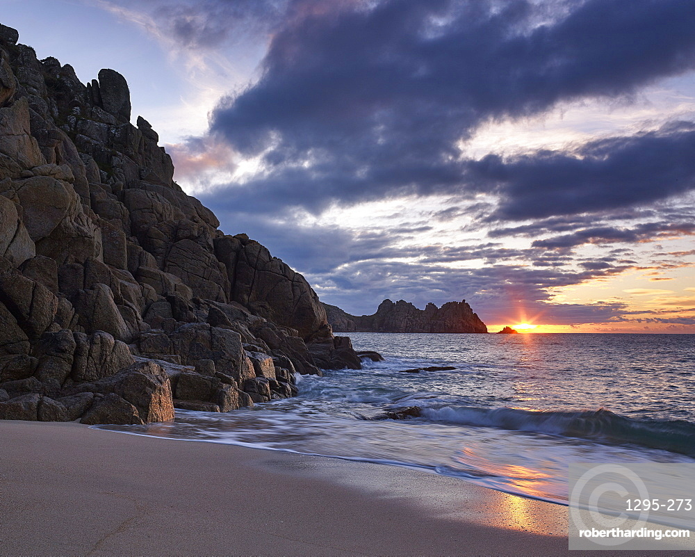 Early morning on the beach looking out towards Logan Rock at Porthcurno, Cornwall, England, United Kingdom, Europe