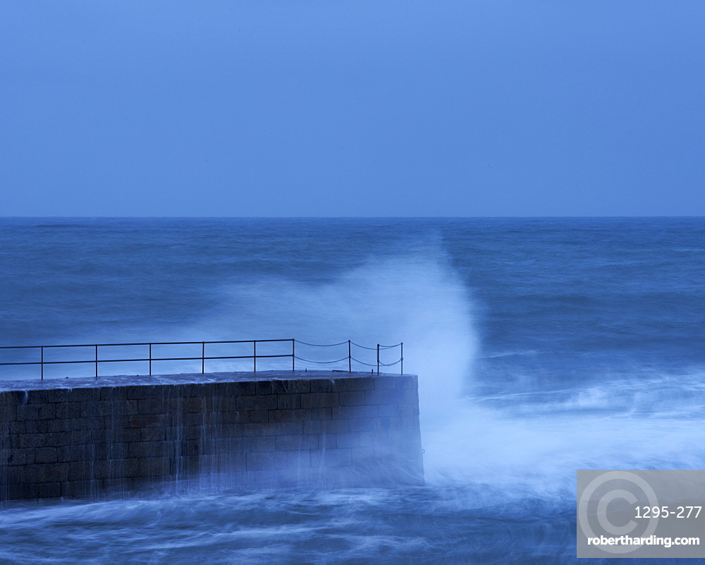 Wave in a storm strikes the breakwater at Porthleven in Cornwall, England, United Kingdom, Europe