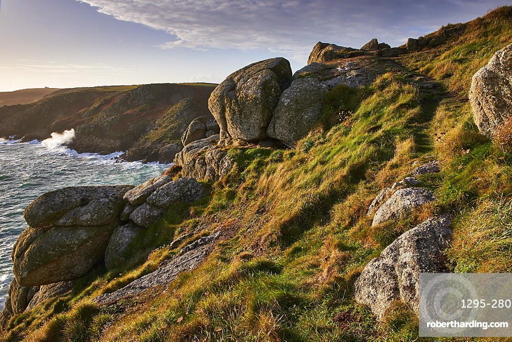 Warm light on Rospletha cliff, Porthchapel, Porthcurno, Cornwall, England, United Kingdom, Europe