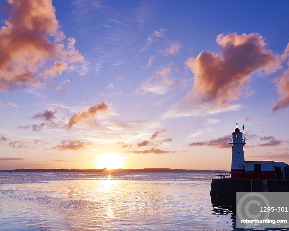 Summer sunrise on the harbour wall at the fishing port of Newlyn, Cornwall, England, United Kingdom, Europe