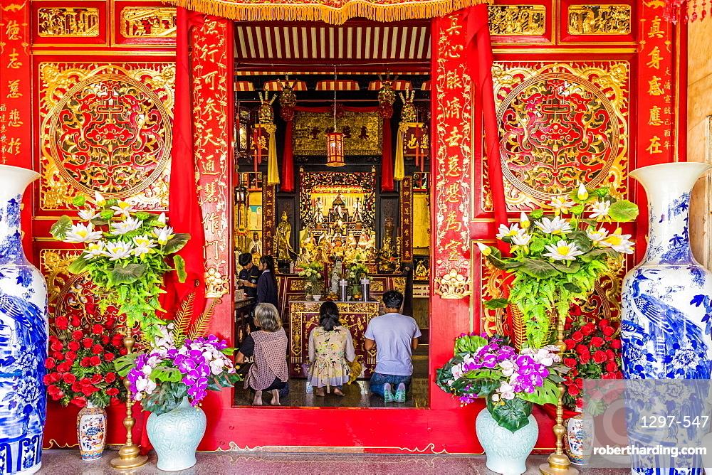 Praying at Jui Tui shrine in Phuket Old Town, Phuket, Thailand, Southeast Asia, Asia