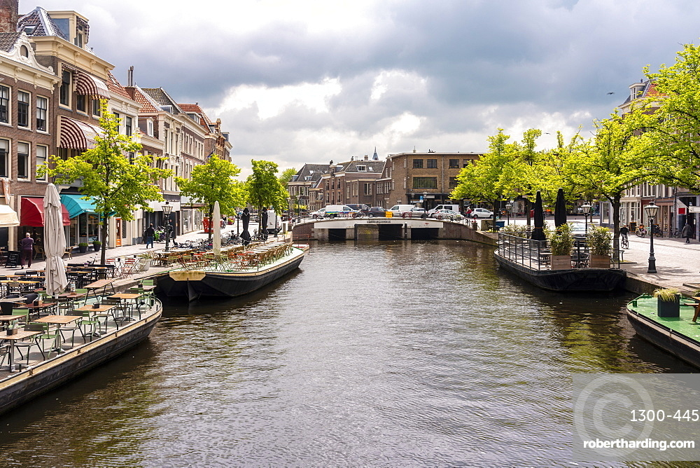 Nieuwe Rijn or new rhine canal with Karnemelksbrug bridge, cafes and shops in the heart of Leiden