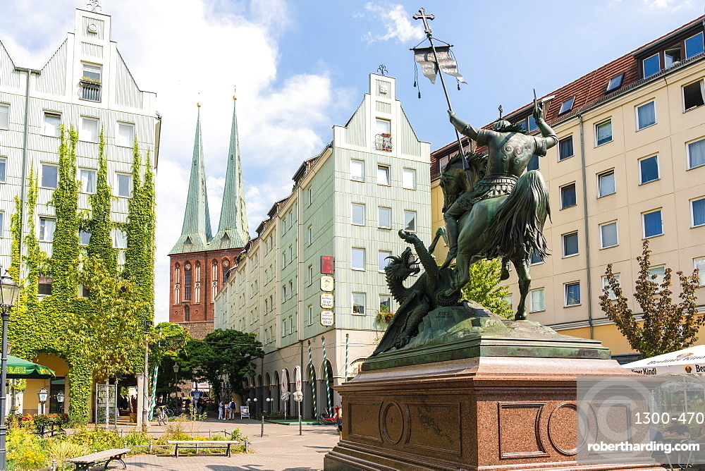 Nikolai viertel quarter by sunset near Alexander Platz with statue of St George Slaying The Dragon and church spires