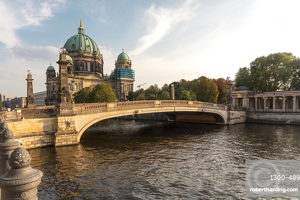 Berliner Dome on Spree river with old bridge on the foreground