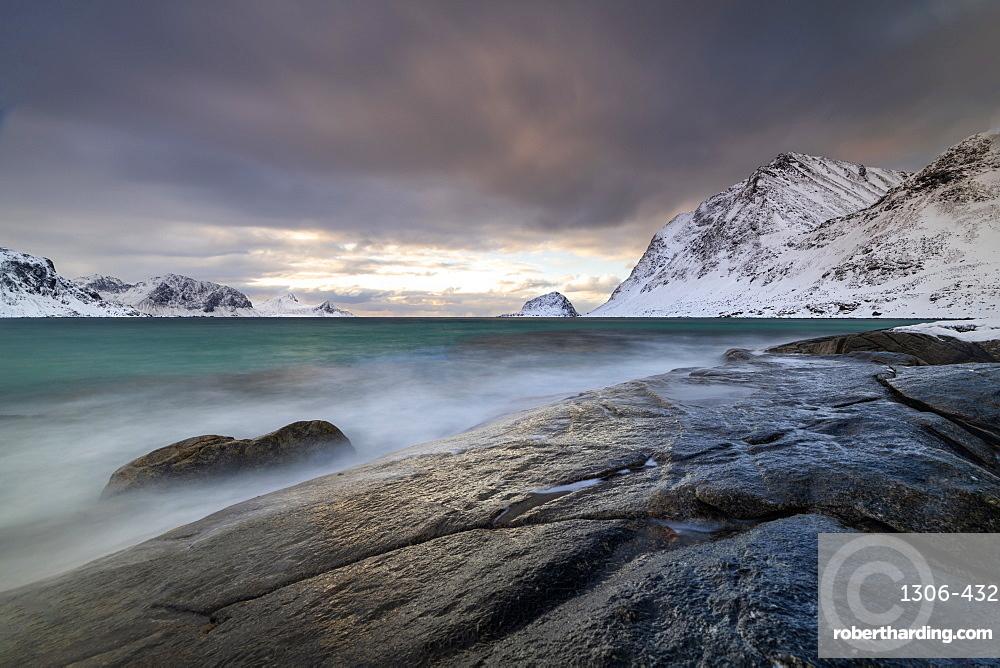 Rock formation in winter at Haukland Beach, Lofoten, Nordland, Norway, Europe
