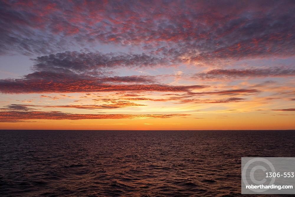 Midnight sun setting over Baltic Sea, Atlantic Ocean, Russia