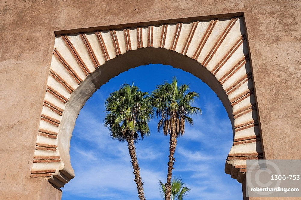 Palm Trees framed in archway, Marrakech (Marrakesh), Morocco, North Africa, Africa