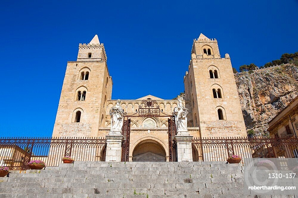 Low angle view of the UNESCO listed 12th century Arab-Norman cathedral from Piazza del Duomo, Cefalu, Palermo, Sicily, Italy