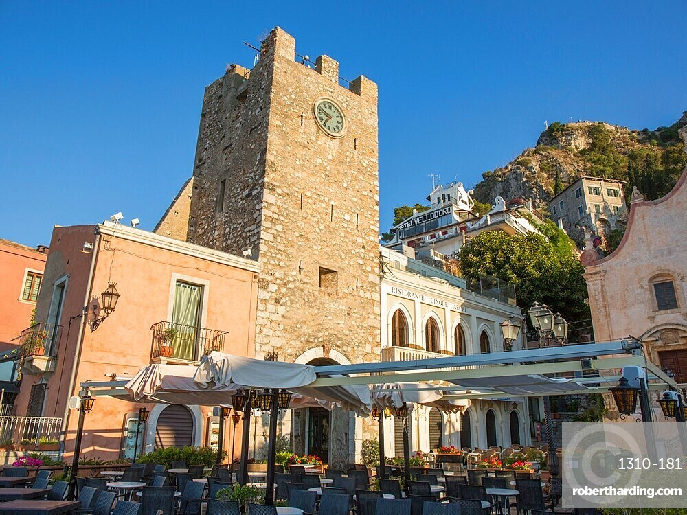 View from Piazza IX Aprile to the 12th century clock tower, Torre dell'Orologio, early morning, Taormina, Messina, Sicily, Italy