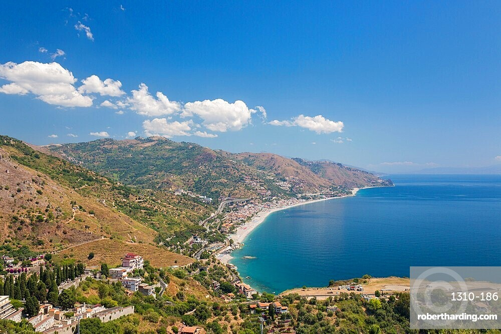 View from the Greek Theatre to the Ionian Sea beach resorts of Mazzeo and Letojanni, Taormina, Messina, Sicily, Italy
