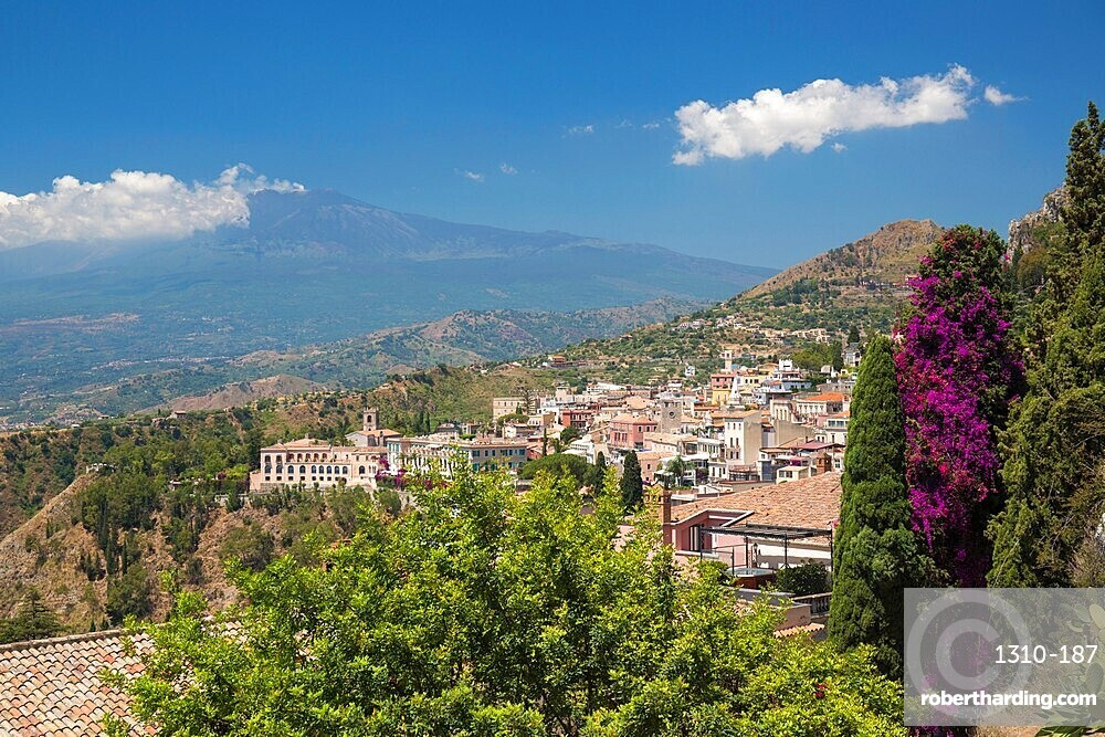 View over the town from the Greek Theatre, Mount Etna in background, Taormina, Messina, Sicily, Italy