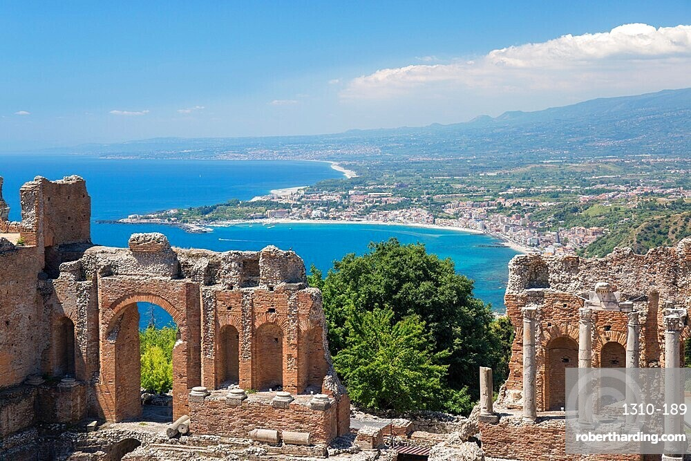 View from the Greek Theatre over the Bay of Naxos to distant Giardini-Naxos, Taormina, Messina, Sicily, Italy