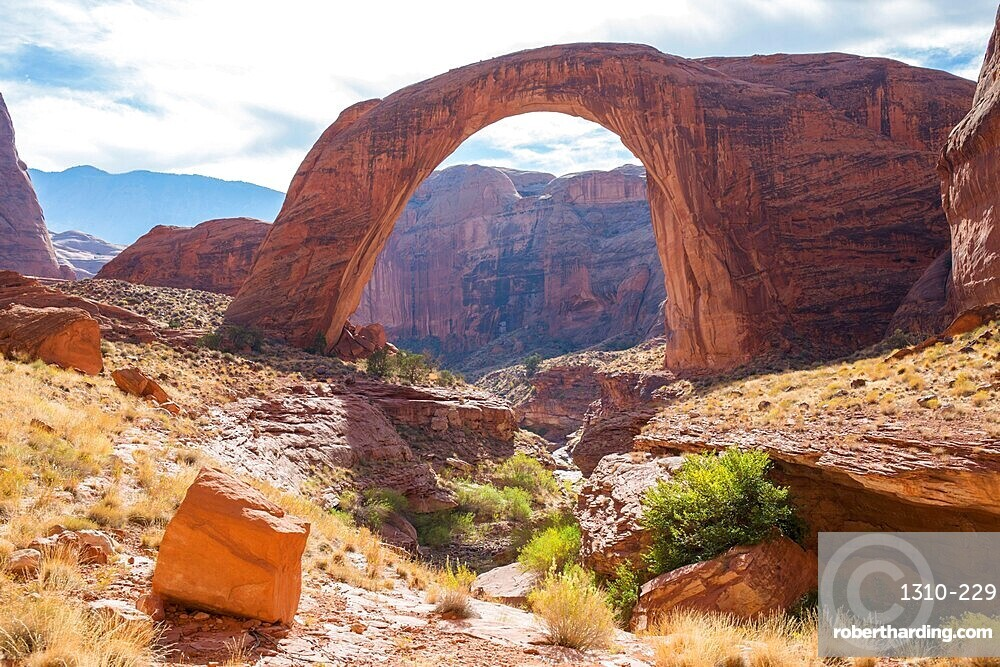 View across rocky landscape to Rainbow Bridge National Monument, Glen Canyon National Recreation Area, Utah, United States of America, North America