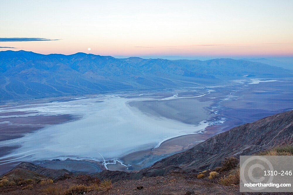 View by moonlight over Badwater Basin to the Panamint Range, Dante's View, Death Valley National Park, California, USA