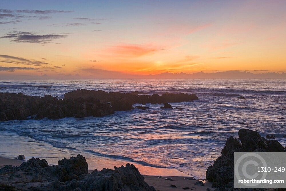 View across the Pacific Ocean from rocky coastline of the Monterey Peninsula, sunset, Pacific Grove, Monterey, California, USA
