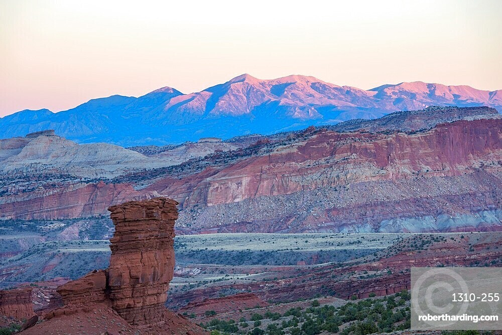 View from Sunset Point to the Waterpocket Fold and distant Henry Mountains, sunset, Capitol Reef National Park, Utah, USA