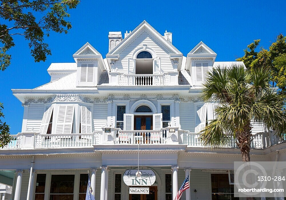 Brilliant white facade of the historic Curry Mansion, now a guest house, Old Town, Key West, Florida Keys, Florida, USA