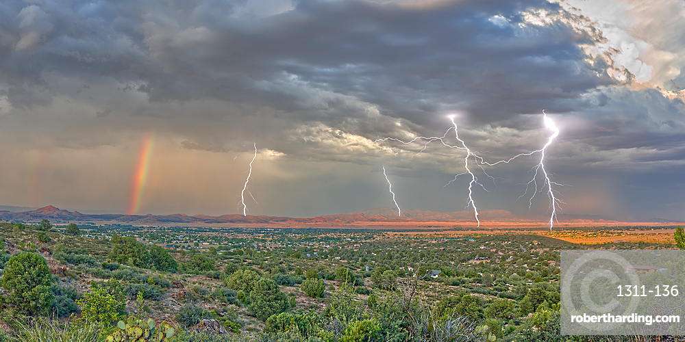 A lightning storm with a rainbow rolling over Mingus Mountain just east of Chino Valley, Arizona, United States of America, North America