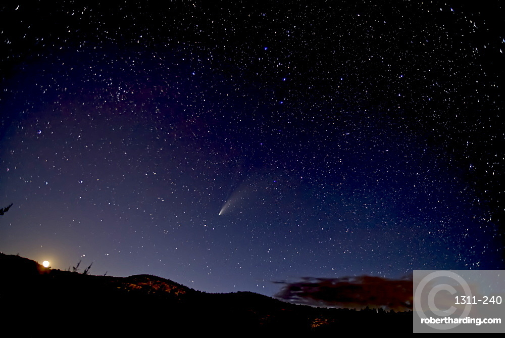 Comet NeoWise 2020 above Sullivan Butte in Chino Valley, with the Moon on the lower left and the Big Dipper in the center, Arizona, United States of America, North America