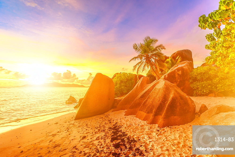 Rocks on beach and palm trees, Anse Source d'Argent at sunset, La Digue, Seychelles, Indian Ocean, Africa