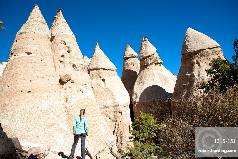 Woman admiring sandstone towers in Kasha-Katuwe Tent Rocks National Monument, New Mexico, United States of America, North America