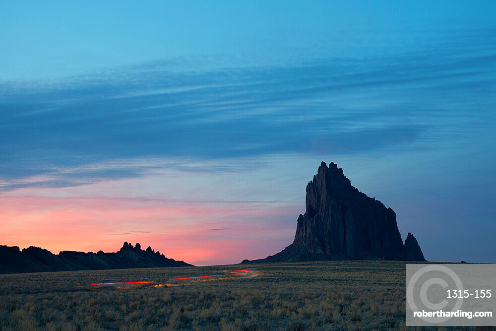 Light trails leading to Shiprock in Farmington at dusk, New Mexico, United States of America, North America